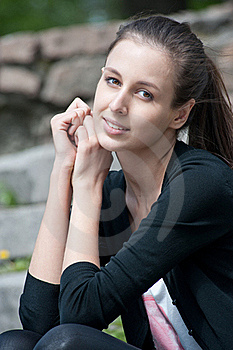 Portrait Of Beutiful Young Woman Sitting Outdoors Royalty Free Stock Photo - Image: 19500725