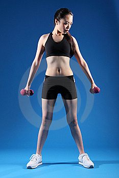 Beautiful Slim Asian Girl Using Exercise Weights Stock Images - Image: 19524104