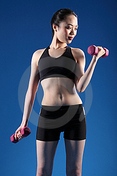 Beautiful Oriental Woman Lifting Fitness Weights Royalty Free Stock Photography - Image: 19524147