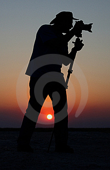 Young Man Taking Pictures At Sunset Stock Photos - Image: 19527773