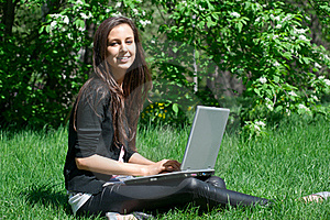 Young Woman Sitting In Park And Using Laptop Stock Photos - Image: 19528753