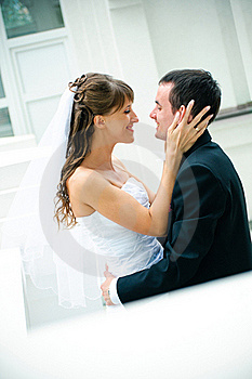 Groom And Bride Embrace. Look Against Each Other Royalty Free Stock Photos - Image: 19541708