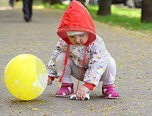 Baby With The Toy And Baloon Royalty Free Stock Photo - Image: 19552915