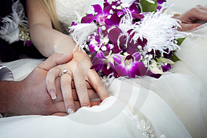 Hands And Rings On Bouquet Royalty Free Stock Image - Image: 19554046