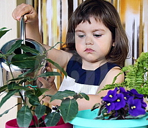 Girl Watering Flowers Royalty Free Stock Images - Image: 19554589