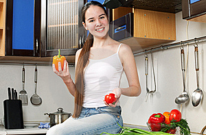 Young Beautiful Caucasian Woman In The Kitchen Royalty Free Stock Photo - Image: 19594485