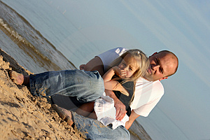 Father And Daughter On A Beach Stock Photo - Image: 1963430