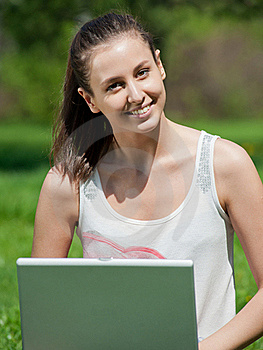 Young Woman Sitting In Park And Using Laptop Royalty Free Stock Photos - Image: 19601638