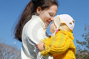 Little Girl With Mother In Spring Park Stock Photos - Image: 19601753