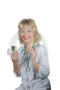 The Woman , Doctor Shows Medicines And Smiles Royalty Free Stock Photo - Image: 19605615