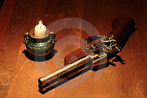 Ancient Pistol And Candle Royalty Free Stock Photography - Image: 19607067