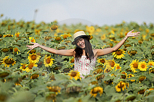 Fun Woman In The Field Of Sunflowers Royalty Free Stock Image - Image: 19607296