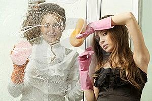 Glamour Girls Washing The Window Royalty Free Stock Photo - Image: 19612155