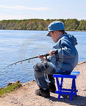 Boy Is Catching Fish Royalty Free Stock Photos - Image: 19613348