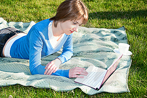 Beautiful Girl Working On Laptop In The Park Royalty Free Stock Photos - Image: 19615448