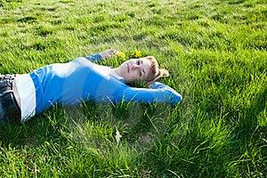Beautiful Girl Lying On The Grass Stock Photos - Image: 19615573