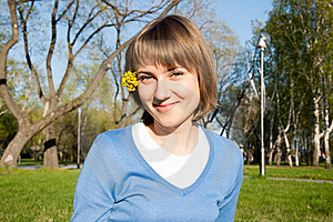 Smiling Girl Sitting In The Park Stock Photos - Image: 19615623