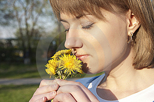 Girl And Dandelions Royalty Free Stock Photo - Image: 19615645