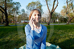 Girl Talking With A Cell In The Park Stock Image - Image: 19615691