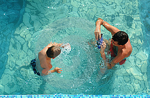 Family In Pool Take Pictures Royalty Free Stock Photo - Image: 19620745