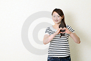 Happy Woman Make Heart Shape By Her Hands Royalty Free Stock Image - Image: 19621566