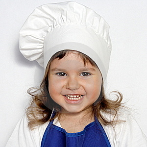 Little Cute Girl In Cook's Cap Portrait Royalty Free Stock Image - Image: 19639636