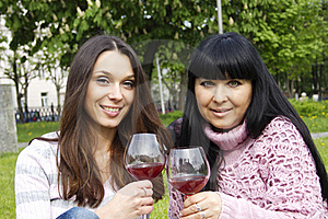 Mother And Daughter Drinking Wine Outdoors Royalty Free Stock Images - Image: 19641459