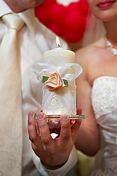Candle In Hands Of Newlyweds Stock Photography - Image: 19645532