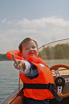 Boy In Life Jacket Pointing Out Royalty Free Stock Photography - Image: 19646027