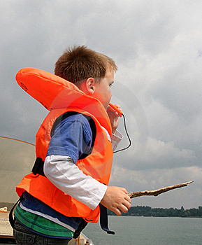 Boy In Life Vest Blowing A Whistle Stock Image - Image: 19646151
