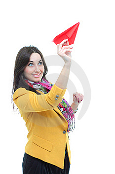 Young Charming Brunette Launching A Paper Airplan Royalty Free Stock Photography - Image: 19654157