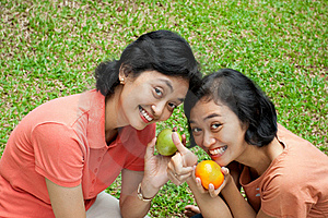 Healthy Asian Women Loves Fresh Fruit Royalty Free Stock Photography - Image: 19656757