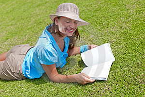 Woman On Grass With Open Book Royalty Free Stock Images - Image: 19668469