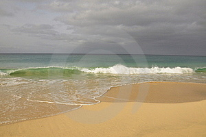 Waves crash onto paradise beach Stock Photos