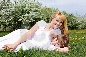 Girl With Mother In Spring Park Royalty Free Stock Photos - Image: 19693818