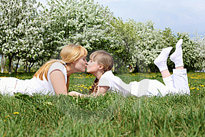 Girl With Mother In Spring Park Stock Images - Image: 19693824