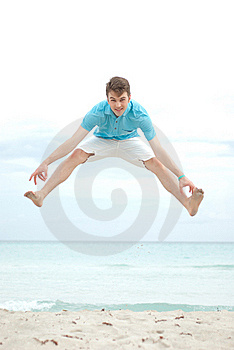 Young Man Jumping On The Beach Royalty Free Stock Images - Image: 19699489
