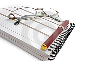 Notebook, glasses and pen Royalty Free Stock Photo