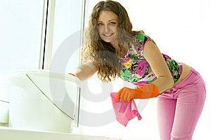 Girl Washing The Window Royalty Free Stock Image - Image: 19703476