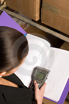 Woman Collecting Data Via Data Terminal Equipment Stock Photo - Image: 19710920