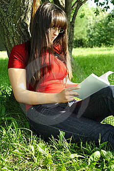 Girl Sitting Near Tree And Reading Book Royalty Free Stock Photos - Image: 19712028