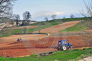 Plowing Tractor Royalty Free Stock Images - Image: 19719279