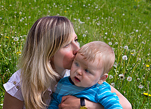 Young Mother Kisses Her Little Son Royalty Free Stock Images - Image: 19724099