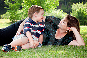 Mother And Son Play Outside On Field Royalty Free Stock Photos - Image: 19725358