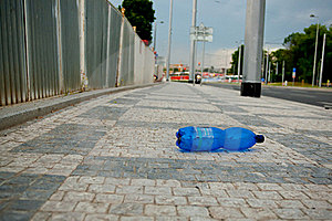 Wasted PET Bottle On Sidewalk Stock Photo - Image: 19725820