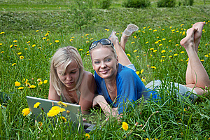 Two Girls Student With A Laptop Royalty Free Stock Image - Image: 19732696