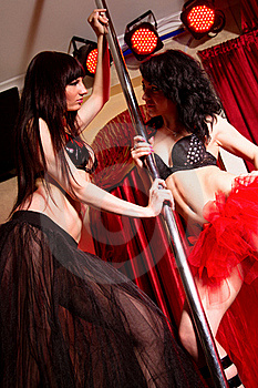 Stripper Girls Dancing Together At The Pole Stock Images - Image: 19740534