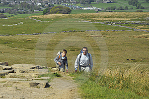 Active Father & Son Hiking On Hill In Countryside Stock Photo - Image: 19762380