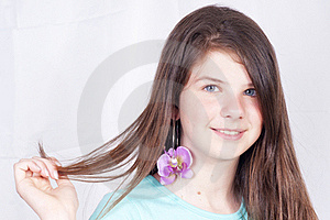 Young Girl Showing Her Earring Royalty Free Stock Images - Image: 19768999