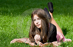 Girl Lying In Th Park Royalty Free Stock Photo - Image: 19769325
